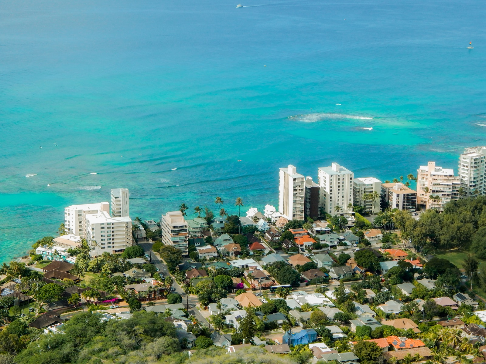 aerial view of buildings and houses by the sea